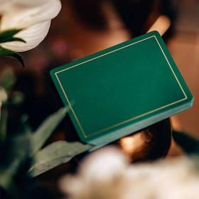 Baraja NOC Out: verde y dorado