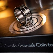 magic trick with coins and rings Opus by Garrett Thomas
